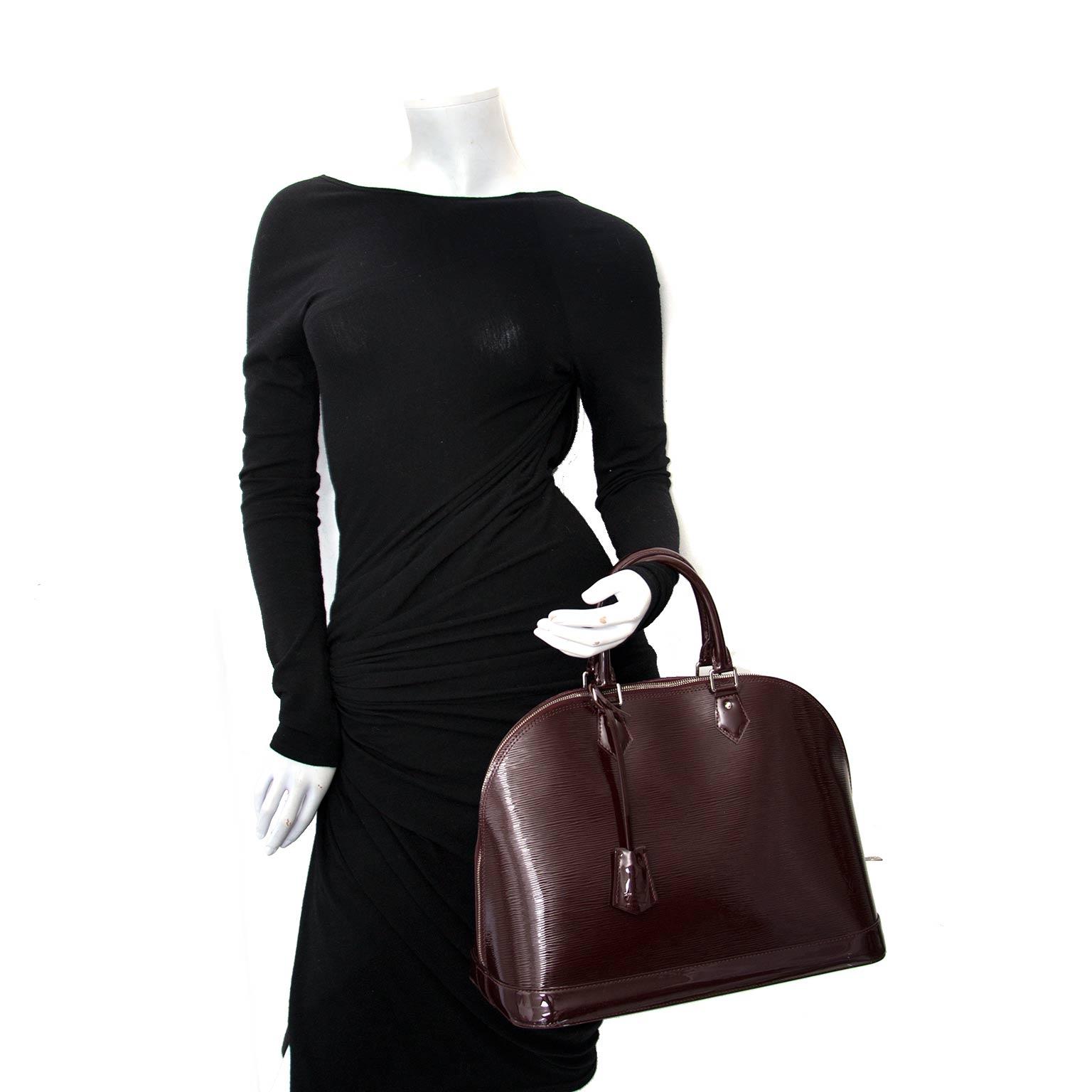 koop online tegen de beste prijs jou tweedehands Louis Vuitton Alma Epi Prune MM