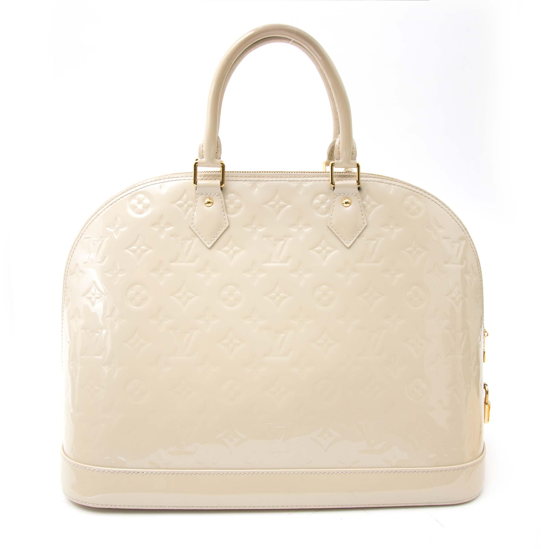 Shop the Louis Vuitton Alma Vernis right now www.labellov.com, the practical everyday bag, Labellov ships worldwide.
