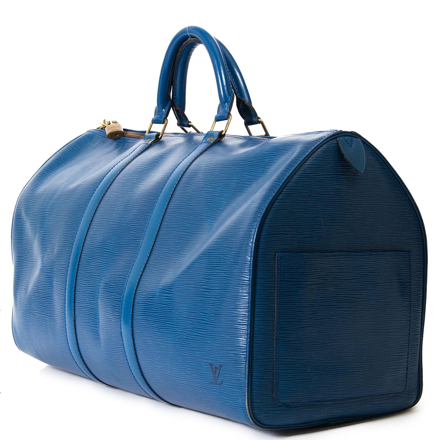 Achetez secur en ligne vitre sac  Louis Vuitton Petrol Blue Epi Leather Keepall pour le meileur prix chez Labellov a Anvers