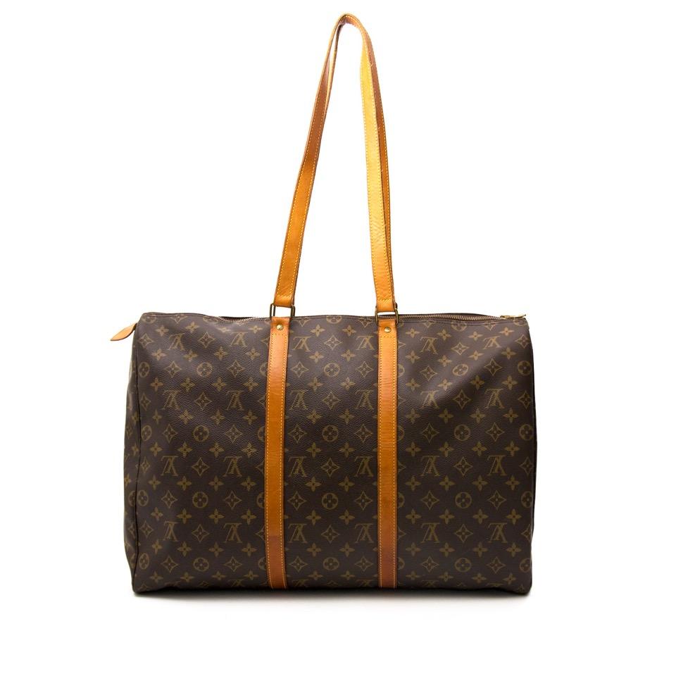 ... Acheter secure en ligne des sacs a mains Louis Vuitton monogram voyage  pour le meilleur prix d62d6e3a5d3