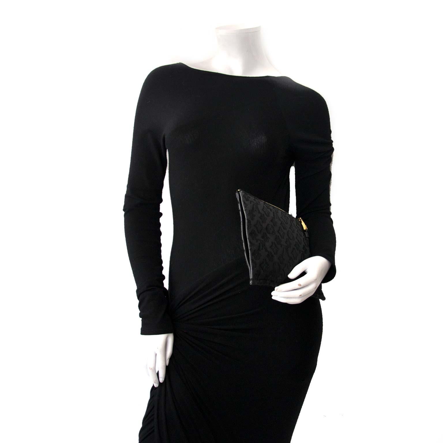 Buy your authentic Louis Vuitton Limited Edition Monogram Fabric Clutch Pochette