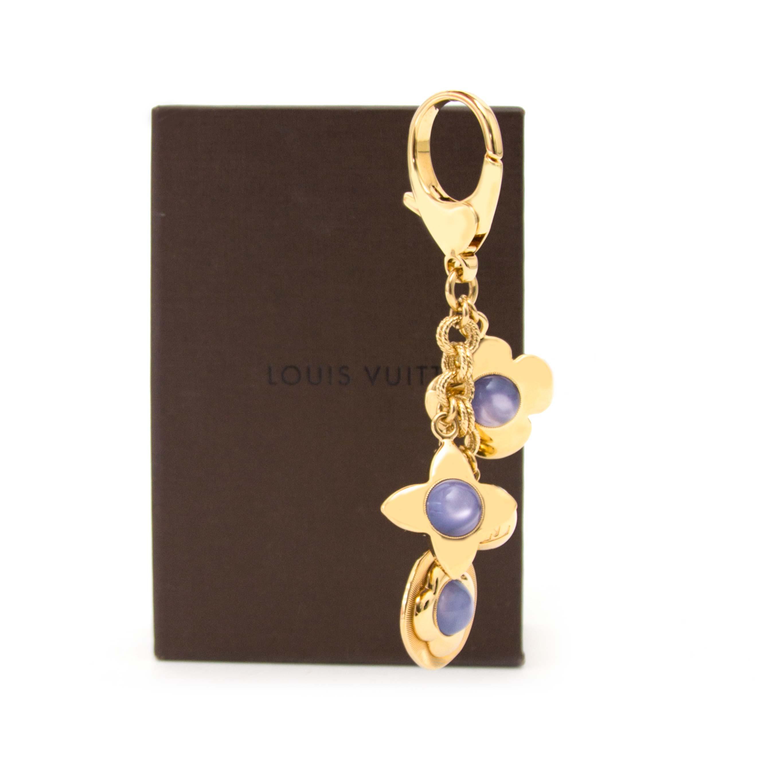 koop veilig online aan de beste prijs jou tweedehands Louis Vuitton Purple Bag Charm