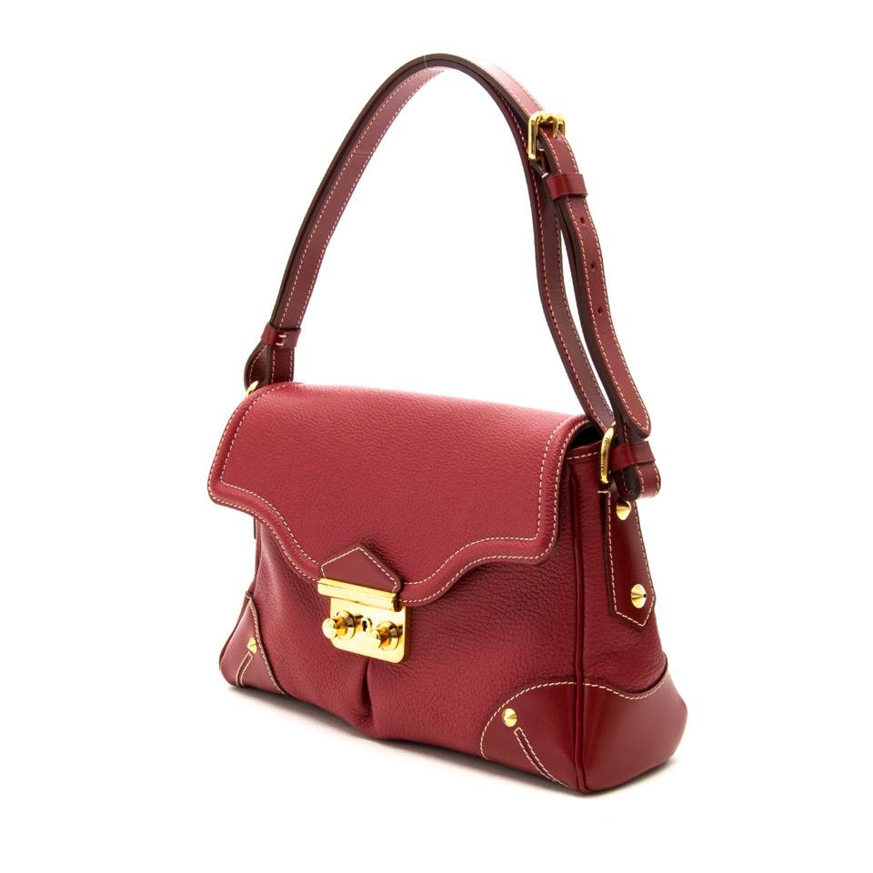 Koop uw authentieke Louis Vuitton Suhali L'Essentiel Tanami rode schoudertas aan de beste prijs van 2016 bij Luxe Webshop labellov