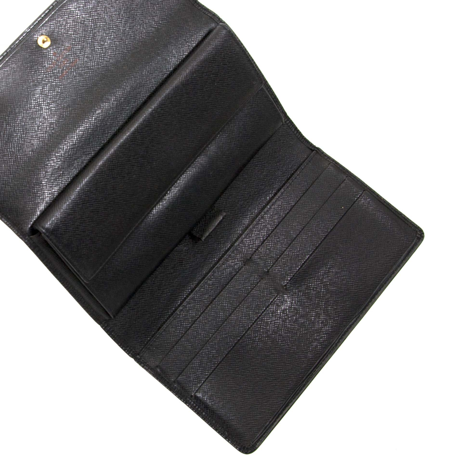 second hand Louis Vuitton Porte-Tresor International Black Epi Leather Wallet now for sale at labellov.com for the best price
