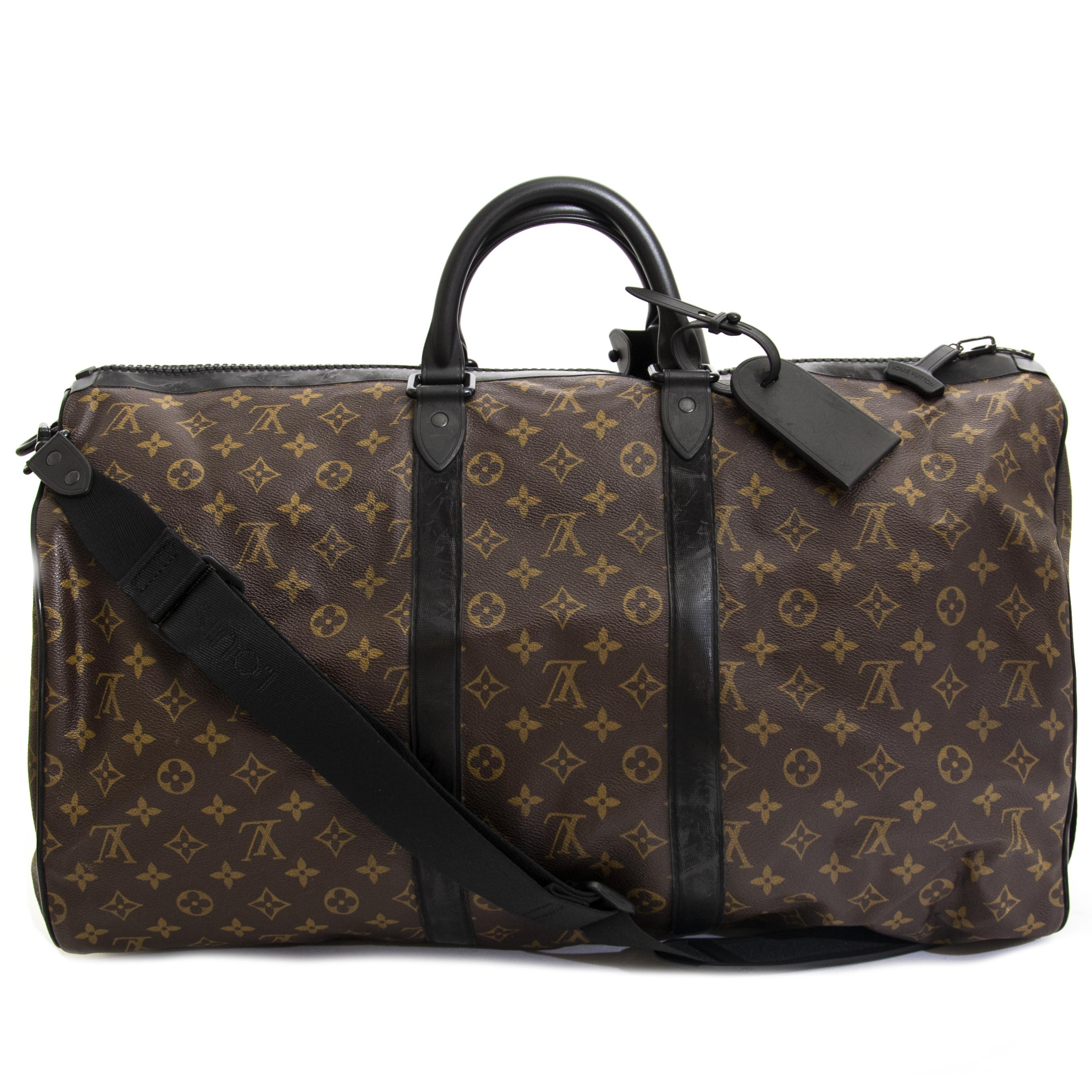 ... Louis Vuitton Waterproof KeepAll 55 Bandoulière now for sale at  labellov vintage fashion webshop belgium 59dff0ded38ea