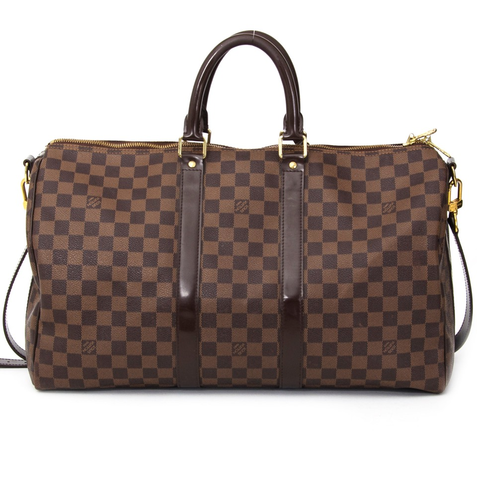 Buy Louis Vuitton Keepall 45 and shoulder strap at the right price at LabelLOV vintage webshop. Luxe, vintage, fashion. Safe and secure online shopping. Antwerp, Belgium.