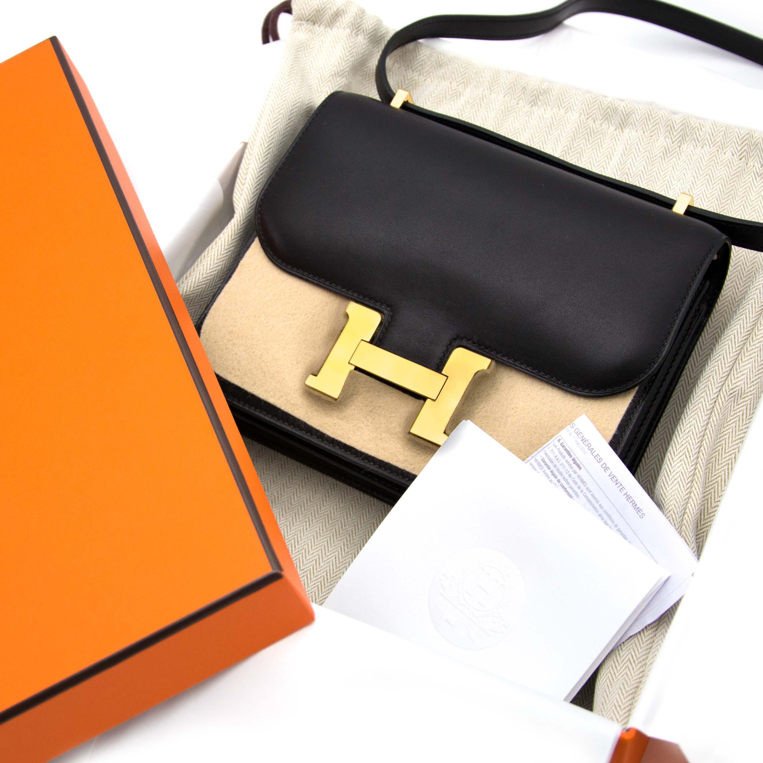 Koop veilig en makkelijk uw authentieke Never Used Hermès Constance 18cm Black Mini Veau Evercalf GHW