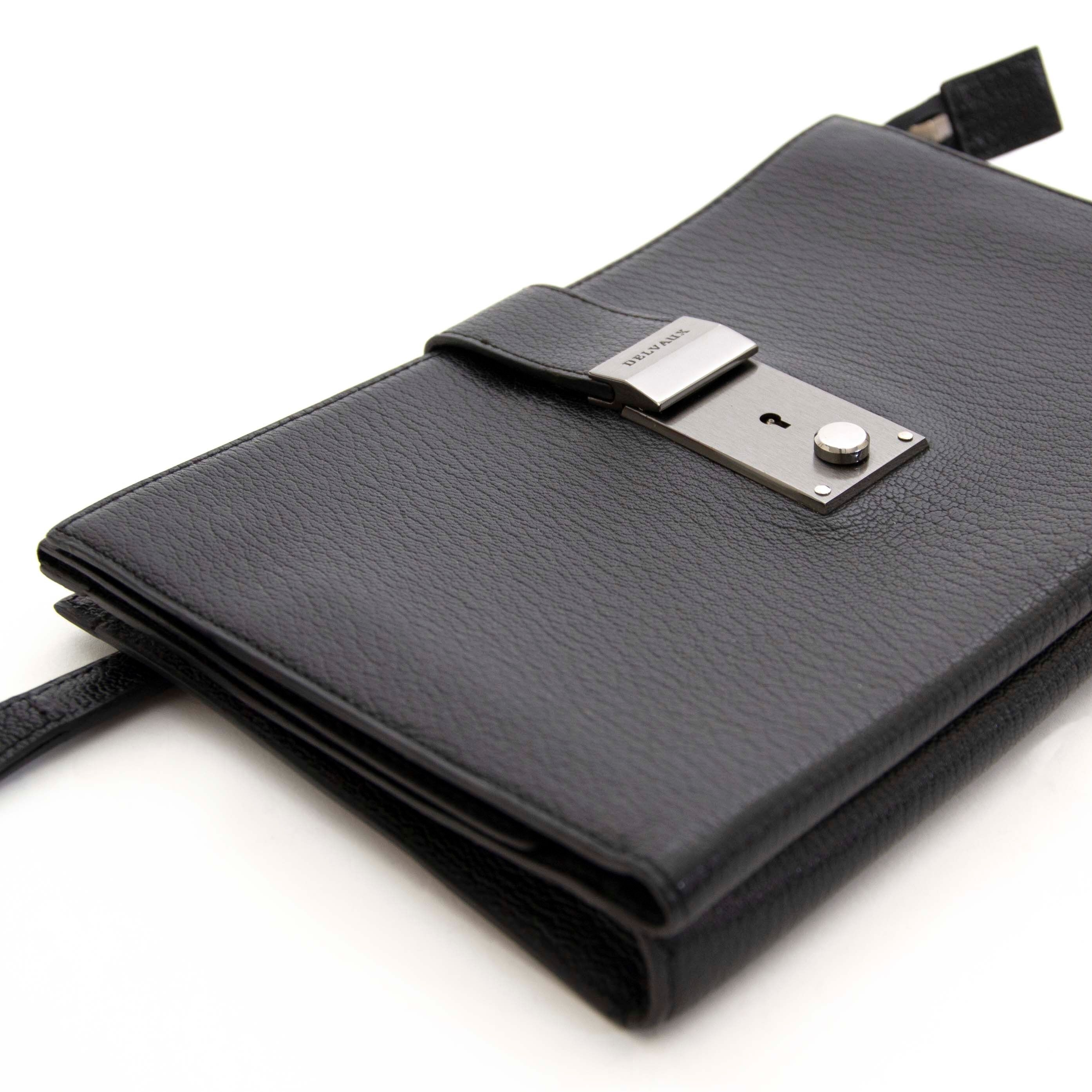 Buy this authentic second hand vintage Delvaux Black Pochette at online webshop LabelLOV