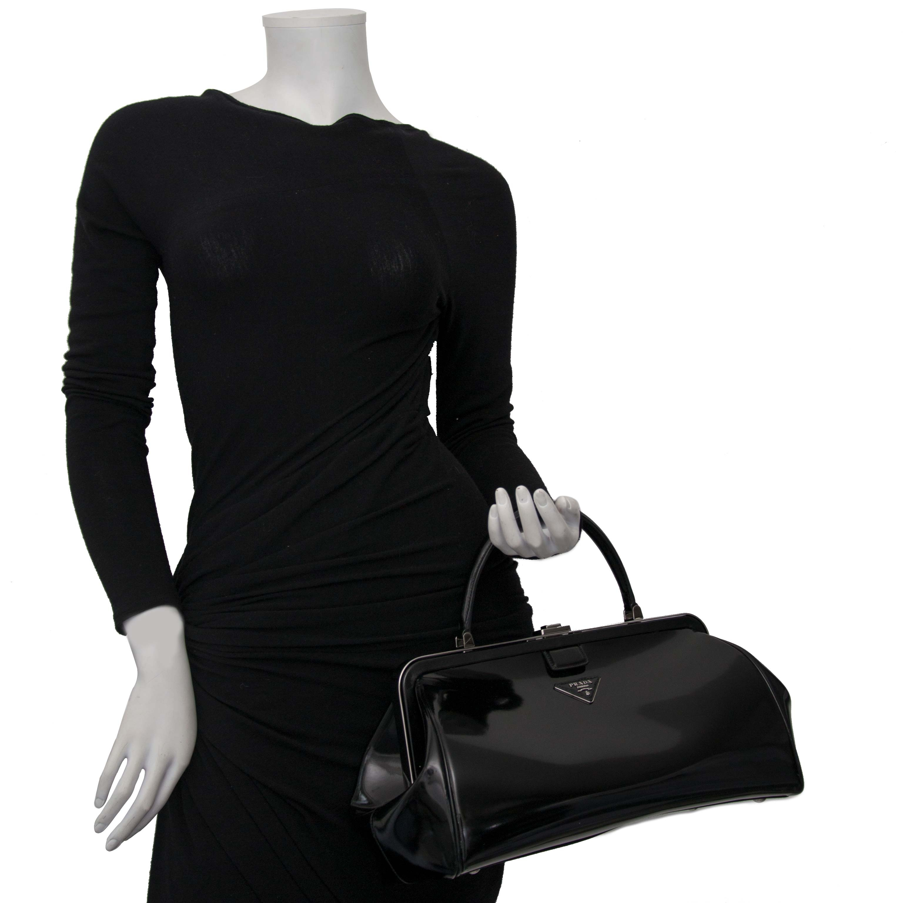 Prada Black Patent Bowling Bag Buy authentic designer Prada secondhand bags at Labellov at the best price. Safe and secure shopping. Koop tweedehands authentieke Prada tassen bij designer webwinkel labellov.