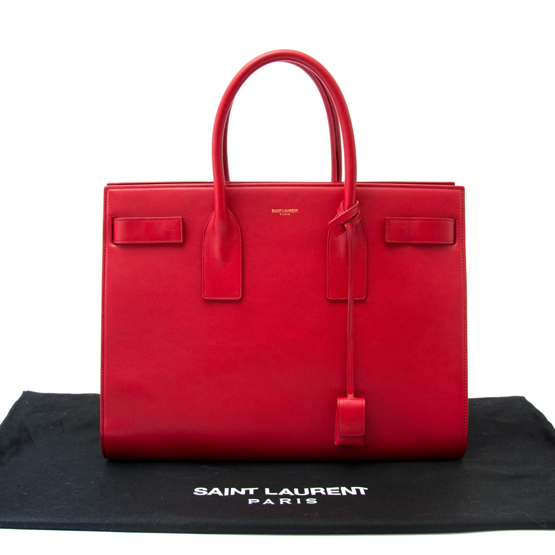266313c58cb0 ... koop online jou tweedehands koop veilig online tegen de beste prijs jou  tweedehands Saint Laurent Red
