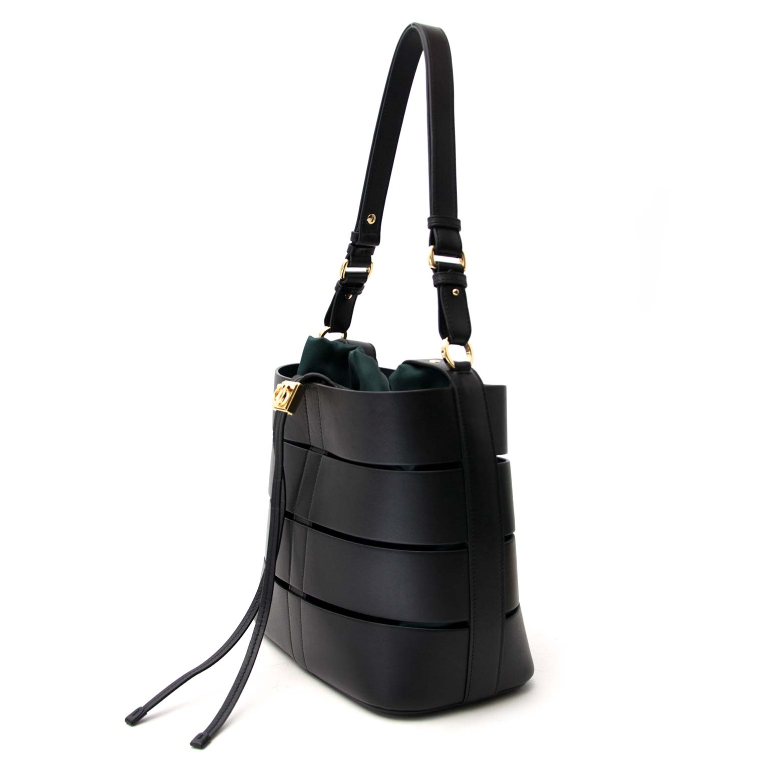 Salvatore Ferragamo Sansy Cutout Leather Bucket Bag Buy authentic designer Salvatore Ferregamo secondhand bags at Labellov at the best price. Safe and secure shopping. Koop tweedehands authentieke Salvatore Ferregamo tassen bij designer webwinkel labellov