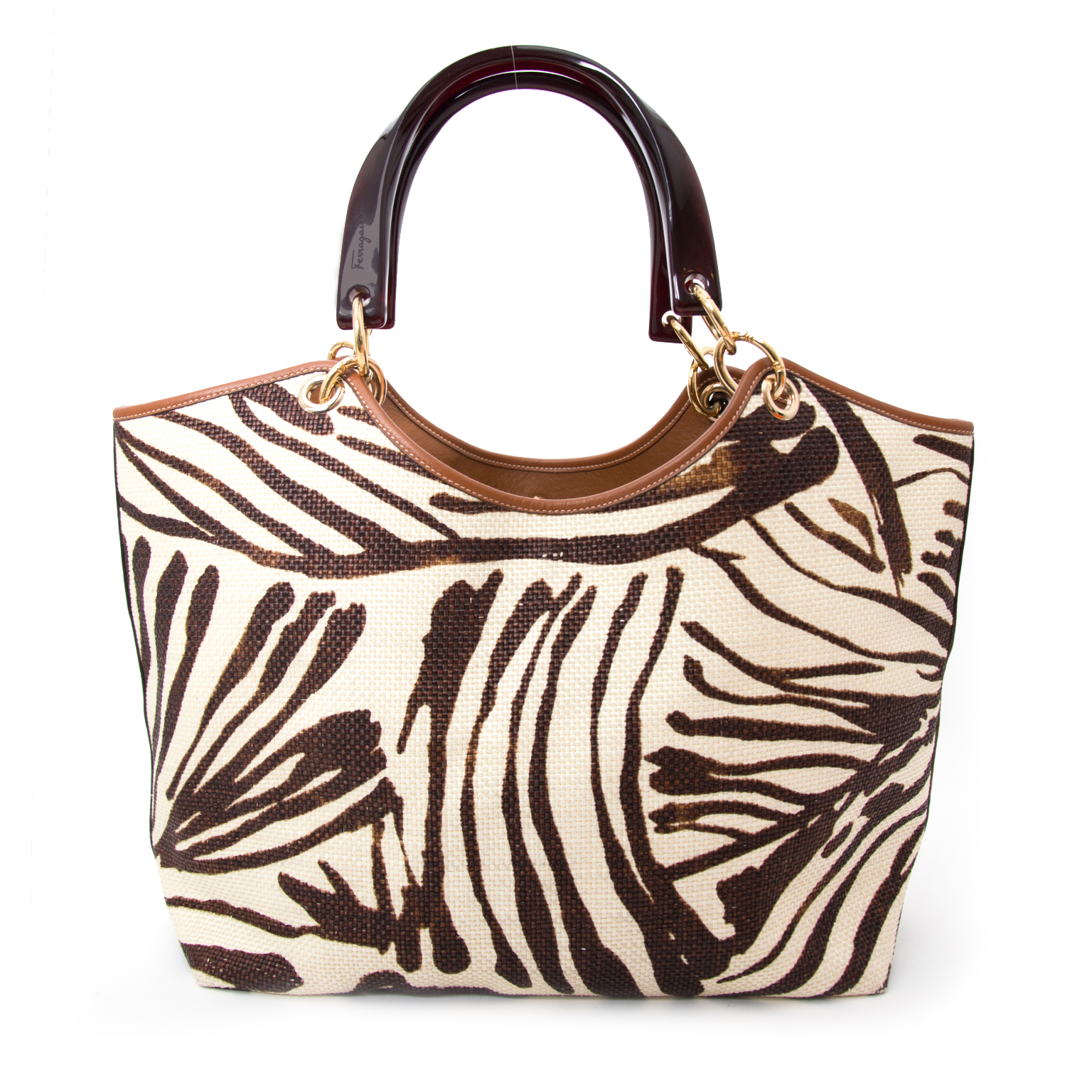 We buy and sell your secondhand designer items from the big brands such as Salvatore Ferragamo Animal Print Shopper