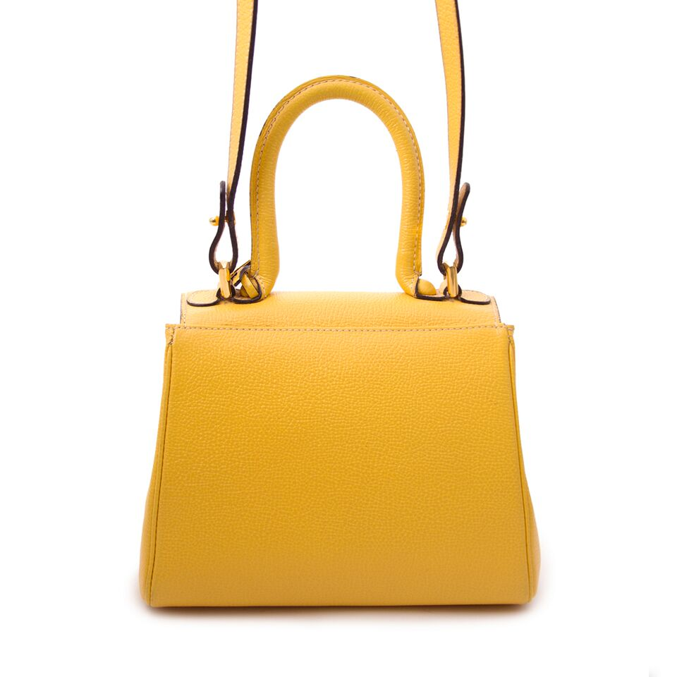 Stunning musthave it-bag Delvaux Brillant Yellow Mini + Strap for sale, luxury and designer items at affordable prices.