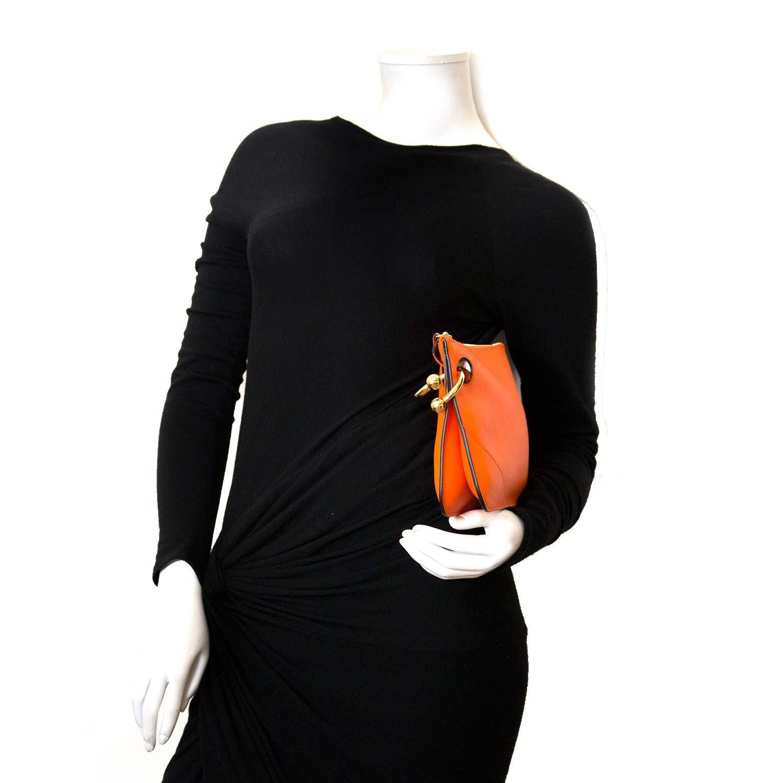 koop authentieke jw anderson tangerine clutch bij labellov vintage mode webshop belgië